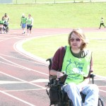 Eric Clow steers his motorized wheelchair around the Yellow Jacket Stadium track