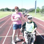 Nancy Crowther and another Fun Runner get ready to do their laps on the Yellow Jacket stadium tack