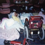 Three people lie on mats on the floor of the Governor's office surrounded by their wheelchairs and bedding.