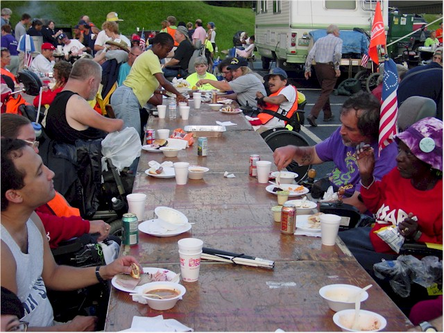 Bob and Barbara Tegmeier, John Hoffman and Gil Casarez are among the ADAPTers eating breakfast at a long table during the ADAPT march from Philly to DC.