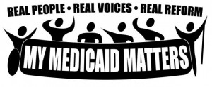 "A group of figures hold up a banner reading My Medicaid Matters.  Above their heads are the words ""Real People, Real Voices, Real Reform"""