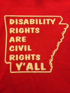 "Outline of state of Arkansas around statement ""Disability Rights Are Civil Rights Y'ALL"""