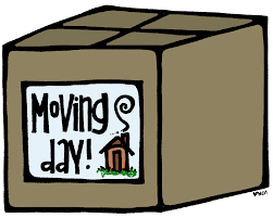 cardboard box with moving day and picture of a house on it.
